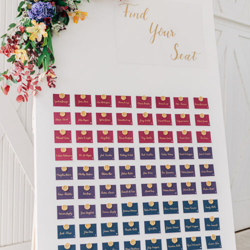 Jewel Toned Escort Card Wall with Gold Calligraphy and Wax Seals at Hangar 9 by CalliRosa