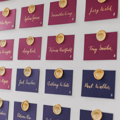 Jewel Toned Escort Cards with Gold Calligraphy and Wax Seal at Hangar 9 by CalliRosa