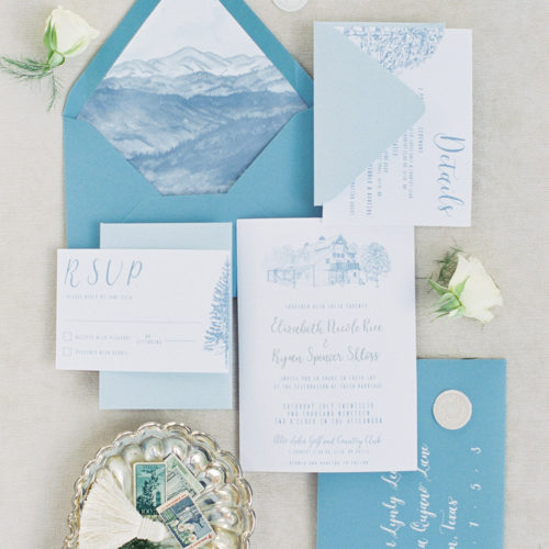Minimalistic Blue Accent Invitation for a New Mexico Destination Wedding with Venue Illustration, Watercolor, and Calligraphy on Woodgrain Paper by CallIRosa