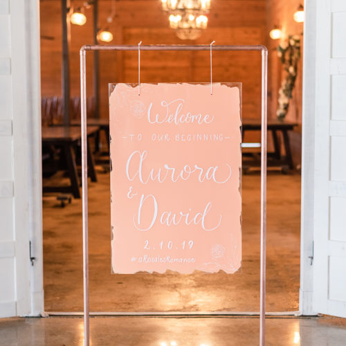 Peach Colored Welcome Sign with Floral Line Drawing on Copper Stand in San Antonio by CalliRosa