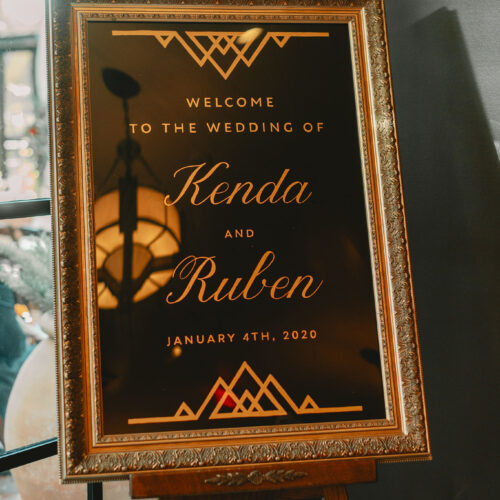 Black Vintage 20's Inspired Welcome Sign with Gold Calligraphy at The Hotel Emma in San Antonio by CalliRosa