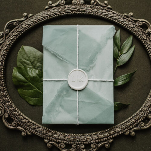 Boho inspired Invitation Suite with Handmade Vellum Wrap and Custom Wax Seal at Ivy Hall in San Antonio Texas by CalliRosa