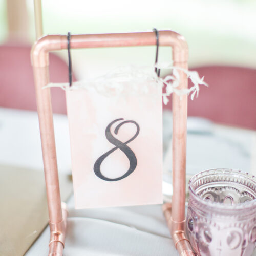Dusty Pink and White Marbled Table Number on Copper Stand with Black Calligraphy at Shiraz Gardens in Austin Texas by CalliRosa