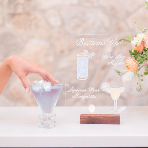 Transparent Acrylic Bar Menu with Drinks Illustrations Martini Moscow Mule and White Calligraphy at Sendera Springs in Kerrville Texas by Callirosa
