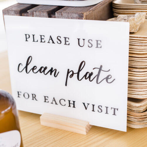 White Acrylic Table Sign with Black Calligraphy at Mae's Ridge in Austin Texas by CalliRosa