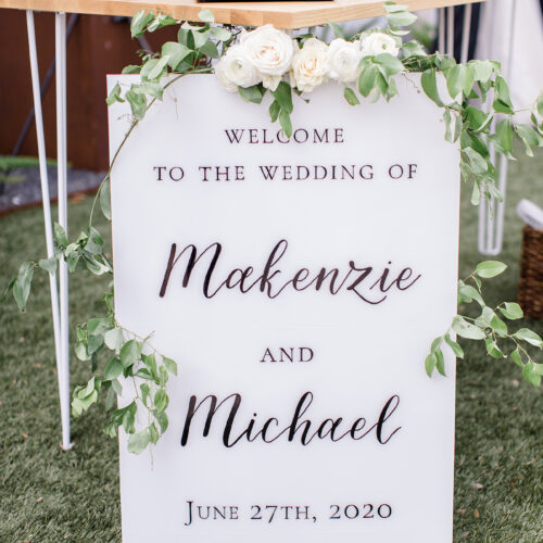 White Acrylic Welcome Sign with Black Calligraphy at Mae's Ridge in Austin Texas by CalliRosa