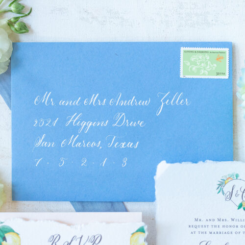 White Formal Calligraphy on Blue Envelope at Sendera Springs in Kerrville Texas by CalliRosa
